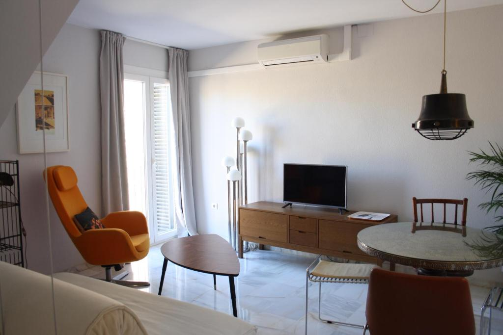 A television and/or entertainment center at Apartment Muralla Macarena