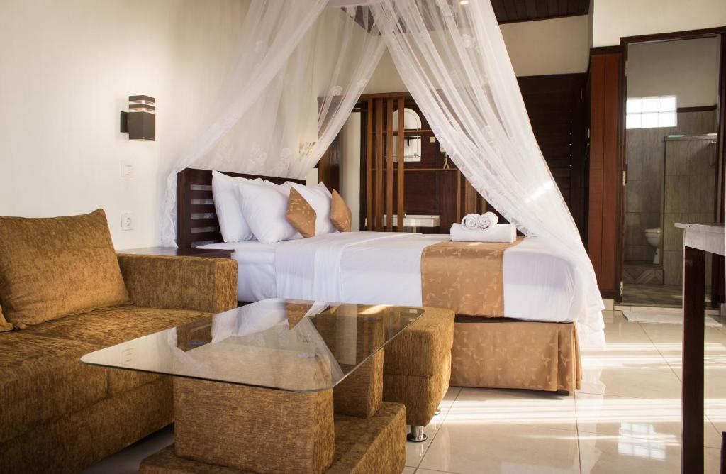 Een bed of bedden in een kamer bij Maliana Homestay