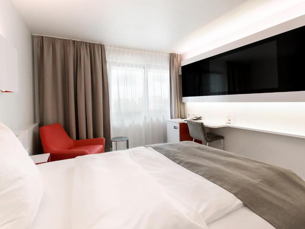 A bed or beds in a room at DORMERO Hotel Hannover