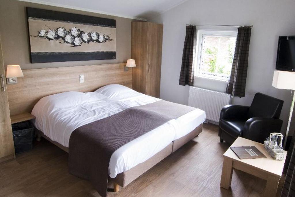 Krevet ili kreveti u jedinici u objektu Hotelkamer