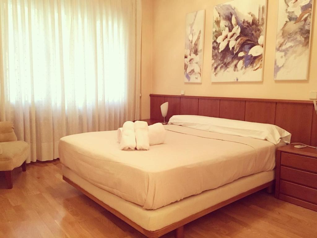 Ein Bett oder Betten in einem Zimmer der Unterkunft Gran Vía 55