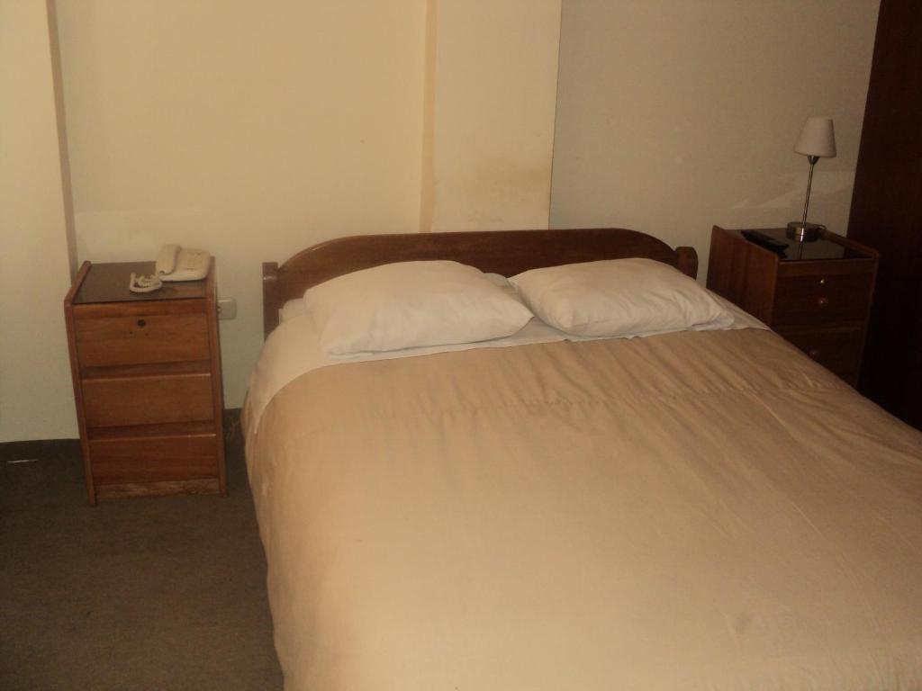 Cama o camas de una habitación en Casa Hospedaje Pekas