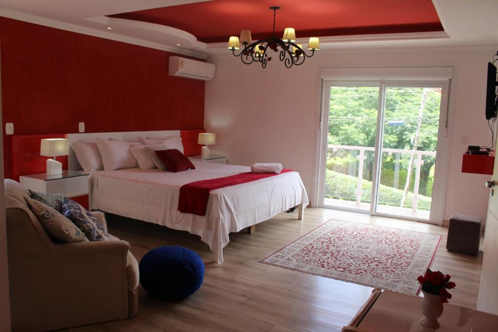 A bed or beds in a room at Amber 449 Hospedagem