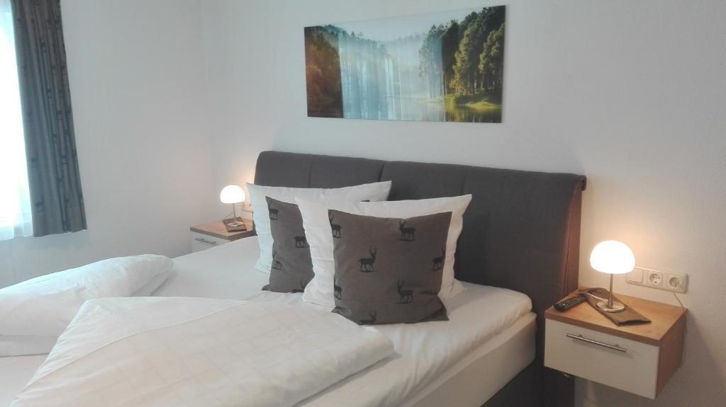 Gästehaus Hosp tesisinde bir odada yatak veya yataklar
