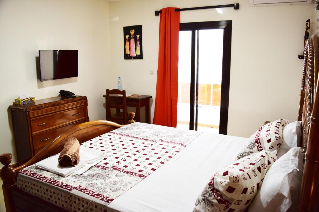 A bed or beds in a room at Hotel Residence Kakatar
