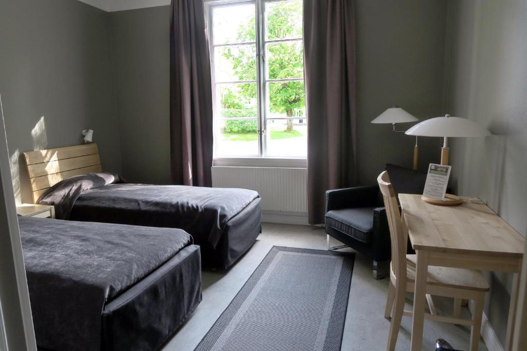 Säng eller sängar i ett rum på Hagabergs Vandrarhem