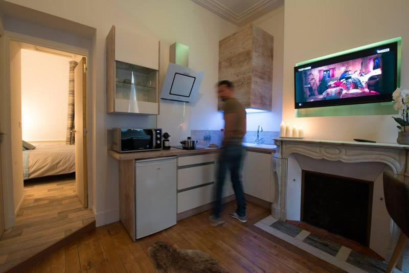 A kitchen or kitchenette at le 29