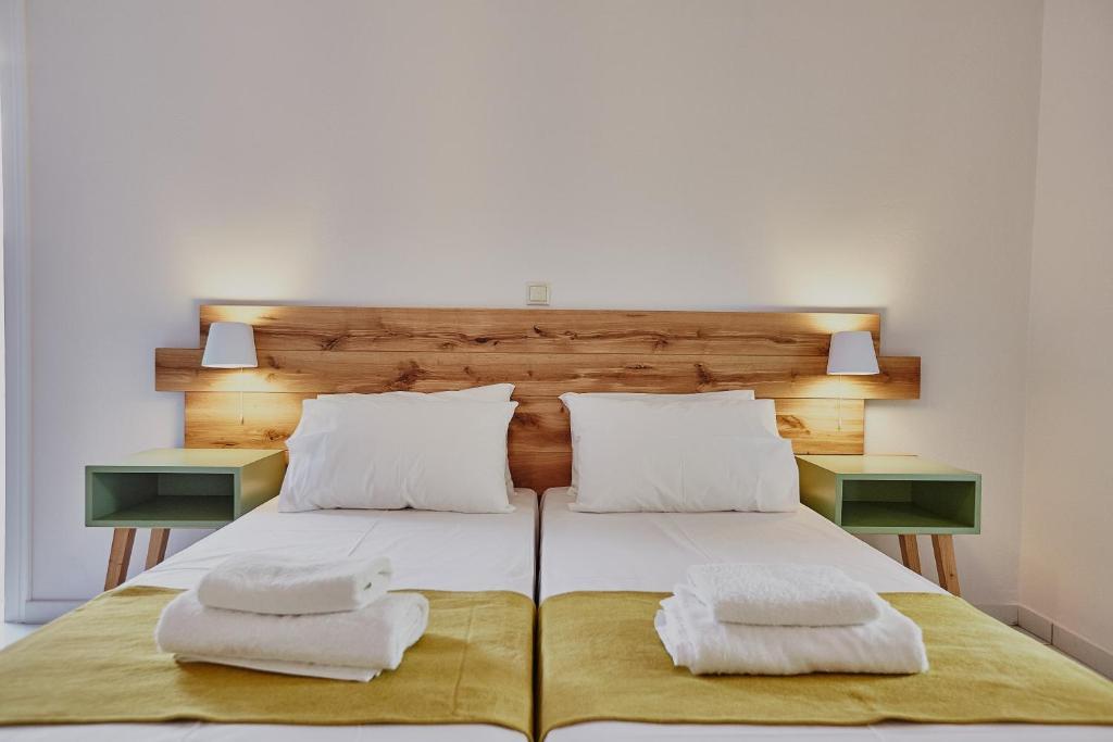 מיטה או מיטות בחדר ב-Irene Studios