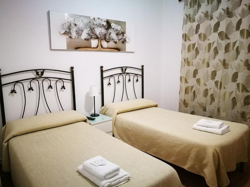 A bed or beds in a room at Apartamento Carabanchel
