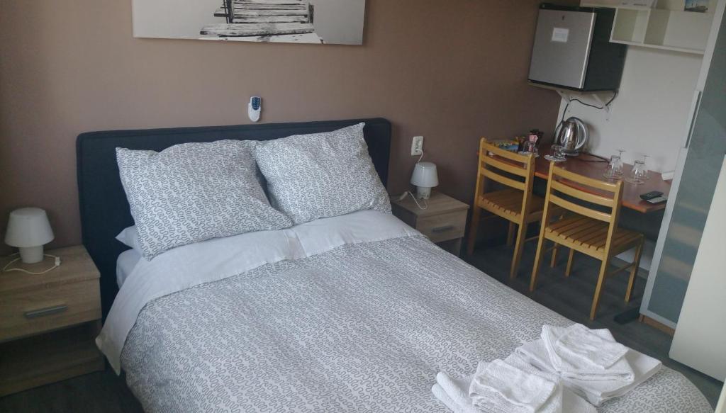 Ein Bett oder Betten in einem Zimmer der Unterkunft Bon Bed & Breakfast