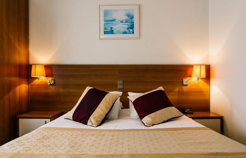 Een bed of bedden in een kamer bij Hotel Prado