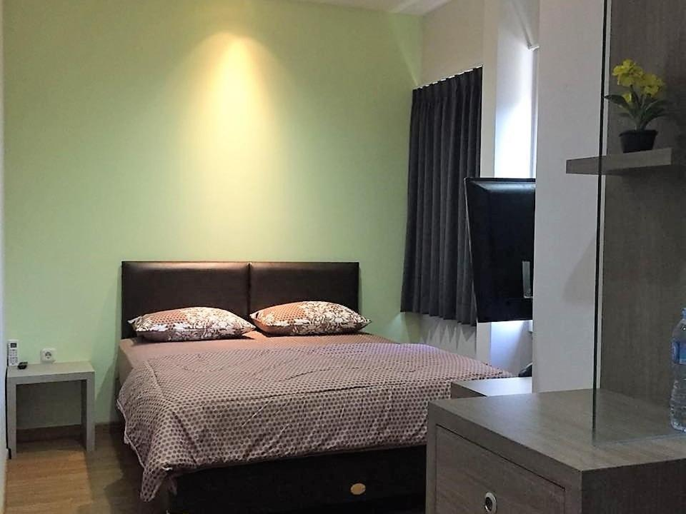 Tempat tidur dalam kamar di Orienchi House