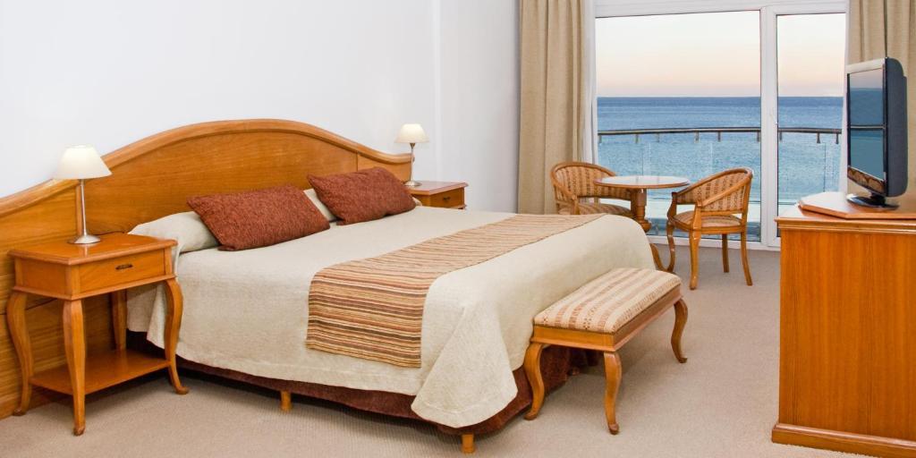 Una cama o camas en una habitación de Hotel Piren