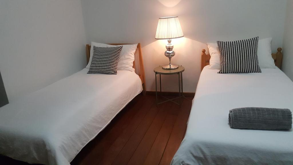 A bed or beds in a room at Preece's B & B