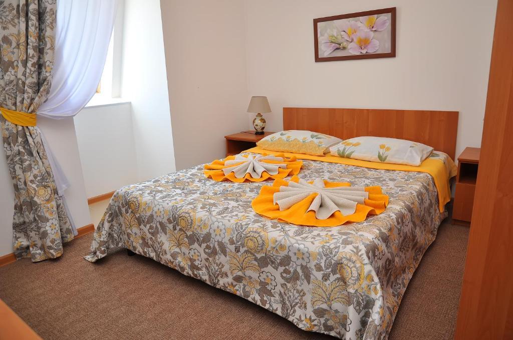 Кровать или кровати в номере Гостевой дом «Атланта»