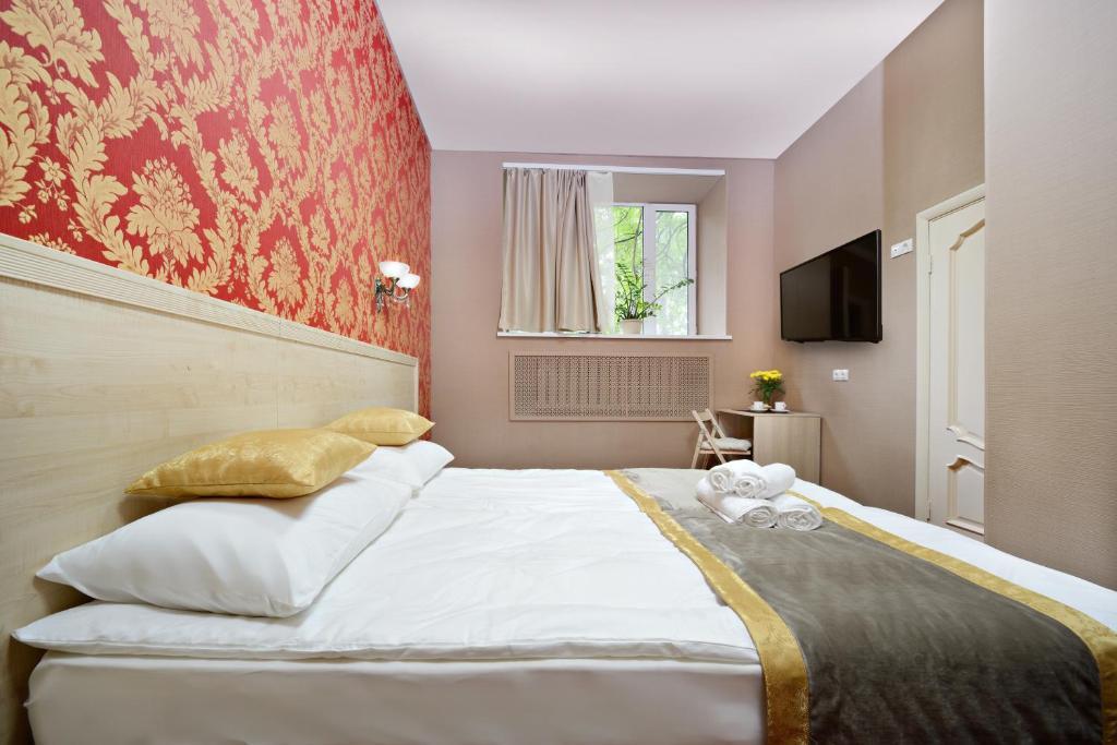 Кровать или кровати в номере Отель Апельсин на Выставочной