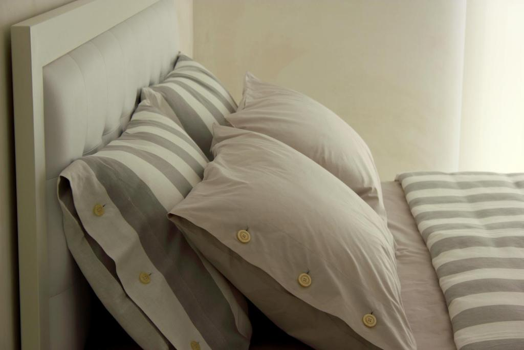 A bed or beds in a room at Home BB Milano