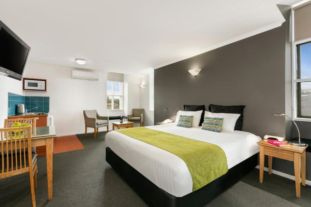 A bed or beds in a room at Quest Waterfront