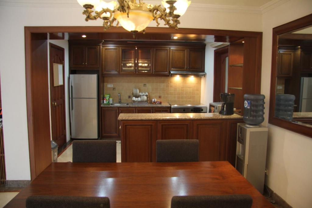 A kitchen or kitchenette at Kusuma Candra 2BR - Pool View
