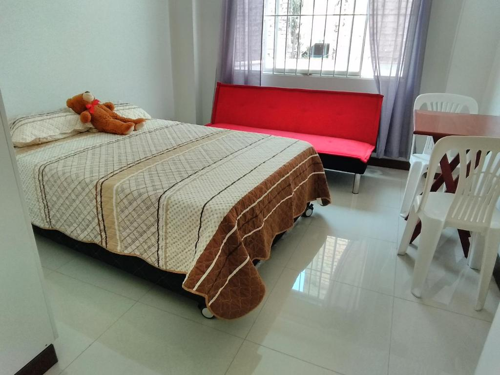 A bed or beds in a room at Love Nest