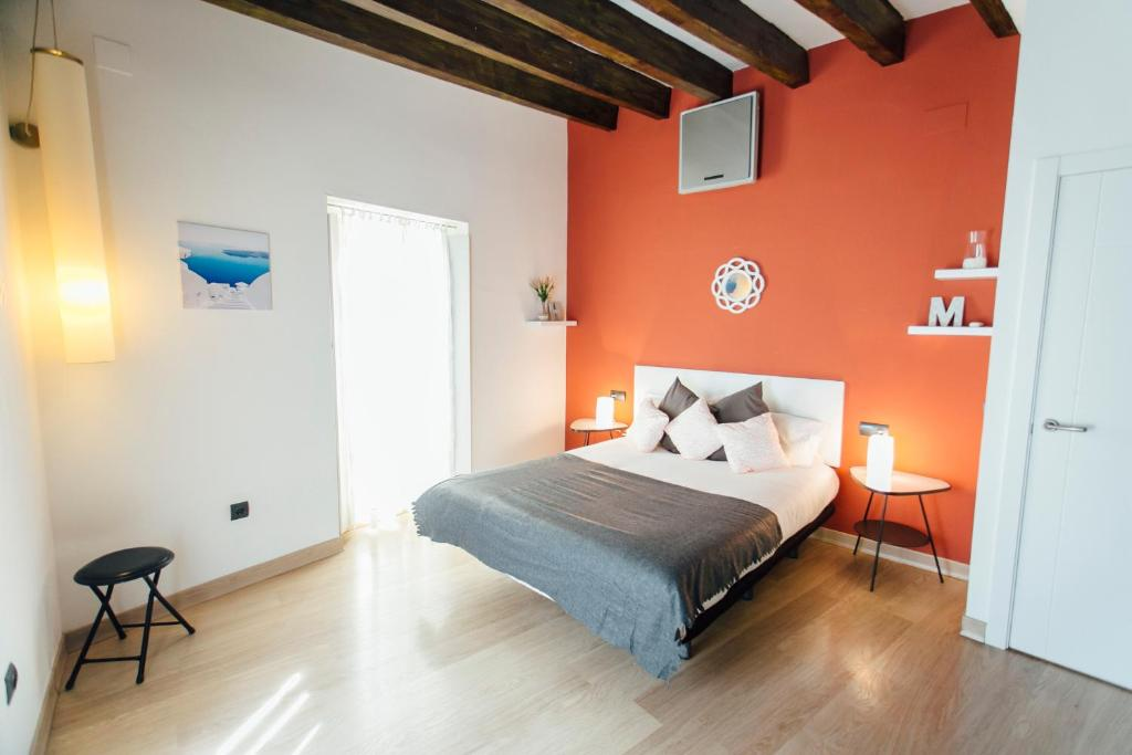 A bed or beds in a room at Triplex con Terraza Celinda