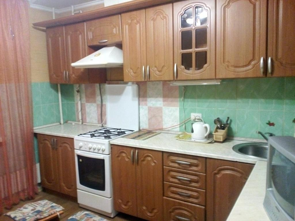 A kitchen or kitchenette at Apartment on Mamadyshsky Trakt