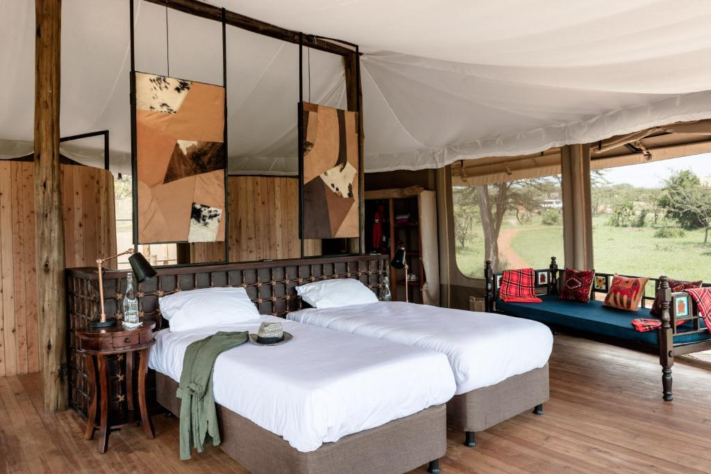 A bed or beds in a room at Leopard Hill