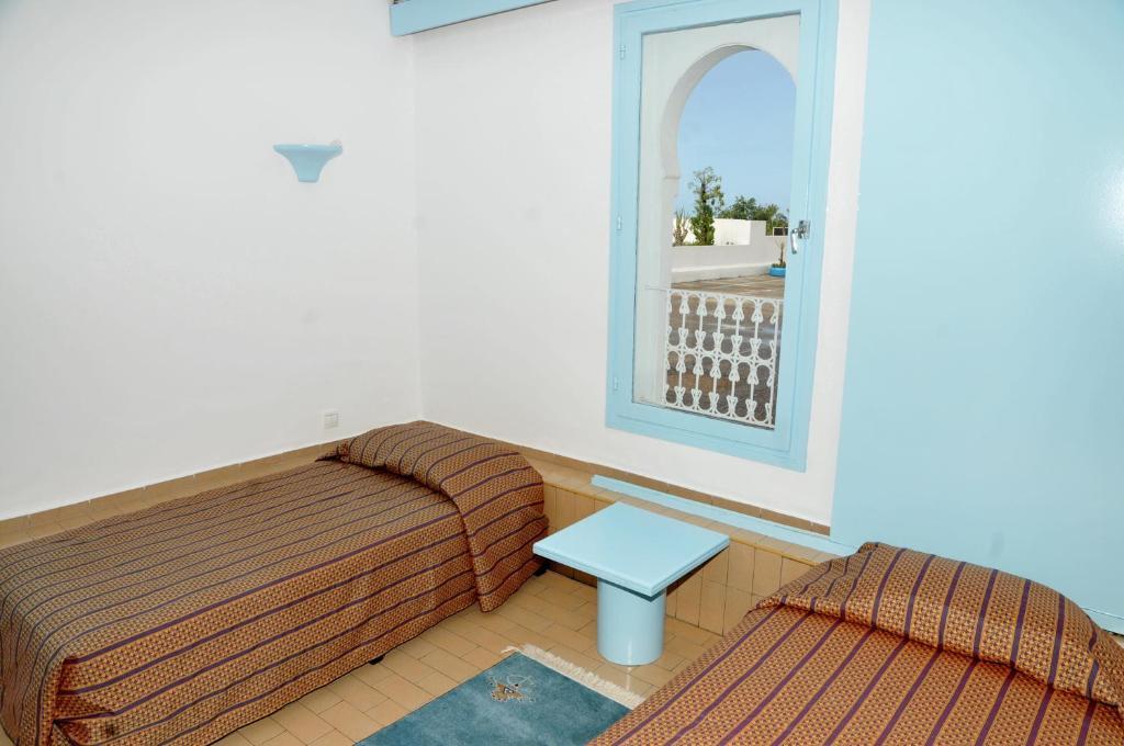 Łóżko lub łóżka w pokoju w obiekcie Résidence Igoudar