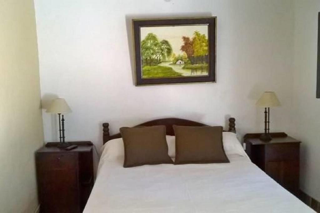 A bed or beds in a room at Hostal Tierra de Vinos
