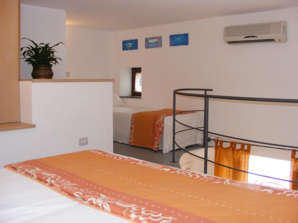 A bed or beds in a room at Casa Mafalda B&B
