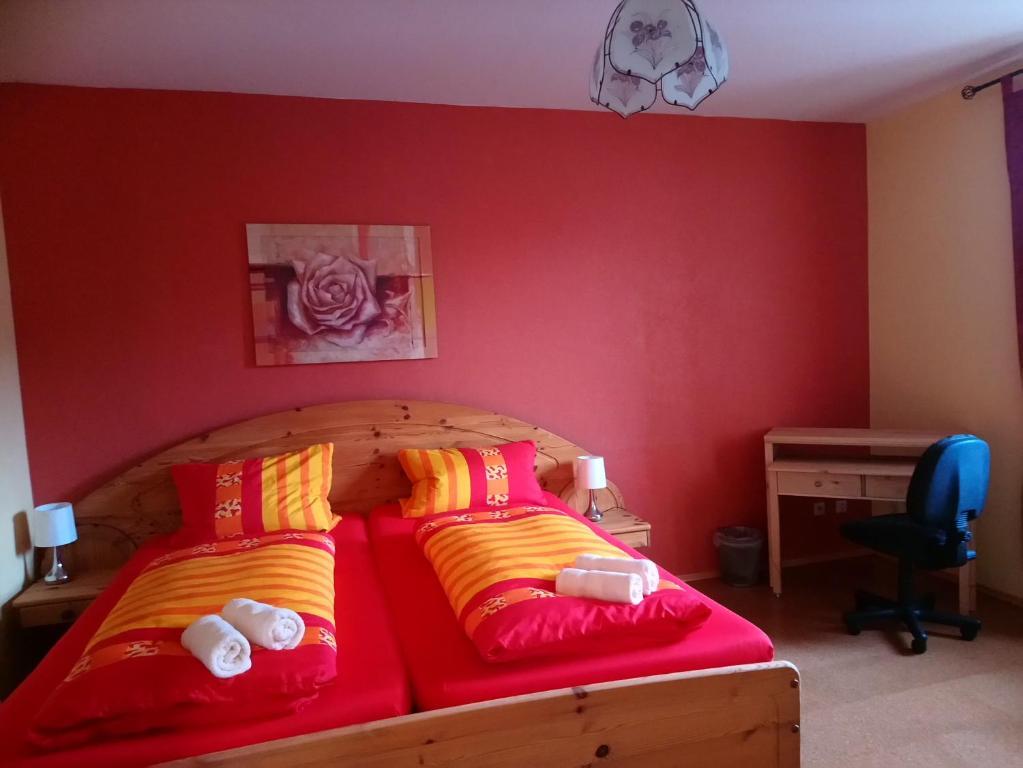 Ein Bett oder Betten in einem Zimmer der Unterkunft Pension Röhrig