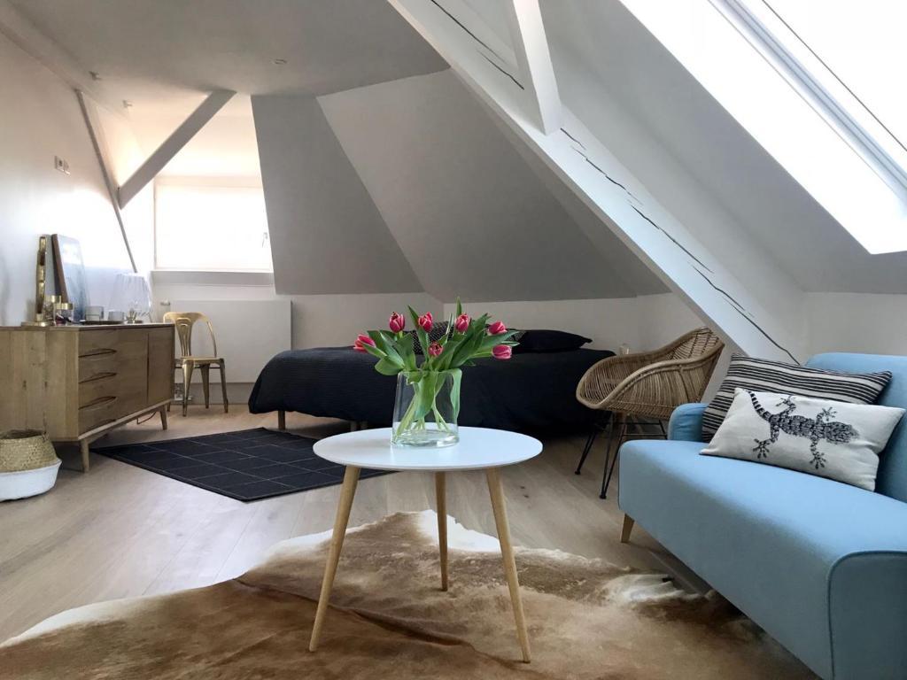 Ein Sitzbereich in der Unterkunft Côté Toit