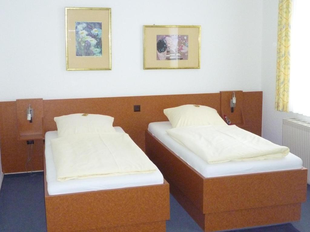Lova arba lovos apgyvendinimo įstaigoje Hotel-Gaststätte Mutter Buermann