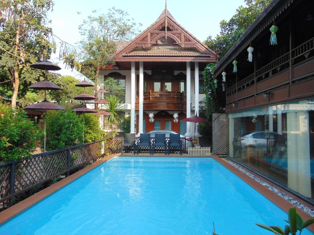 The swimming pool at or close to Pha-Thai House