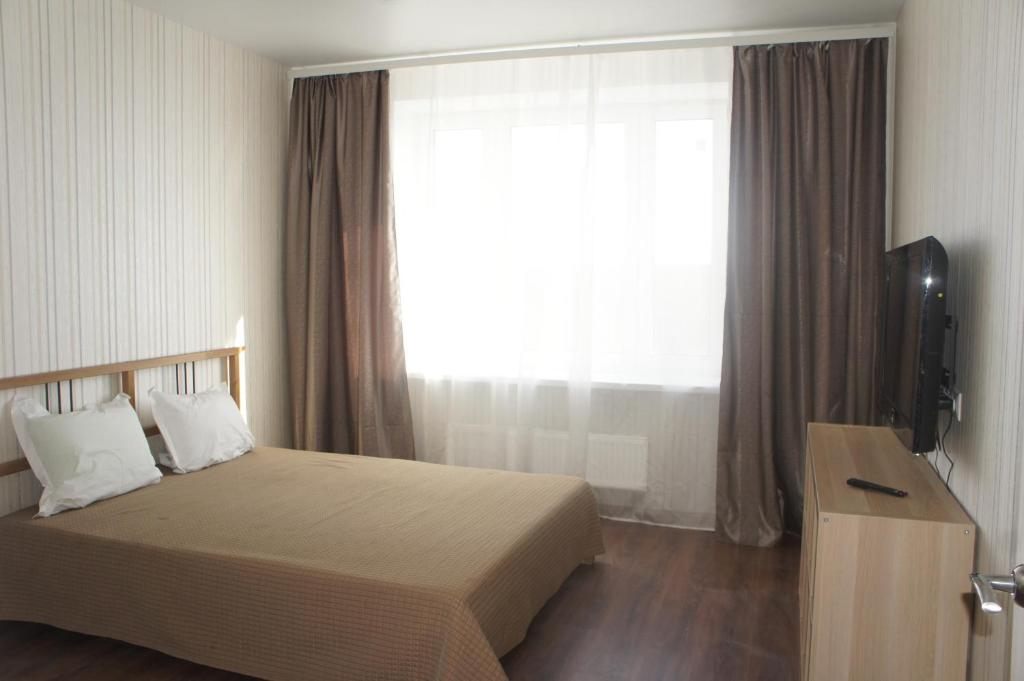 A bed or beds in a room at апартаменты в Домодедово