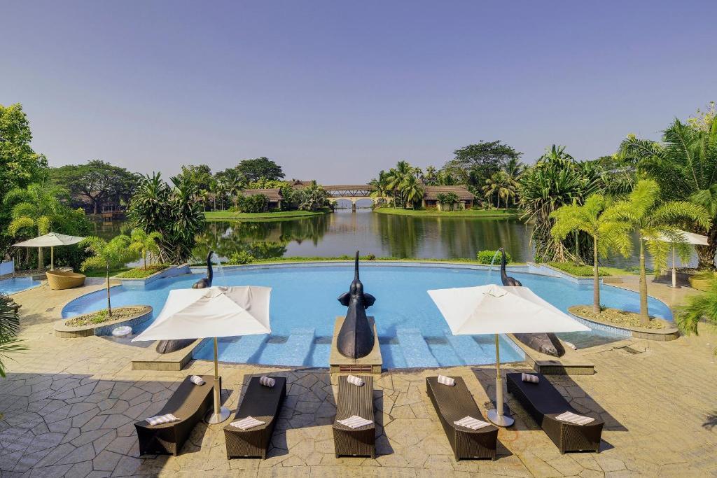 The swimming pool at or near The Zuri Kumarakom Kerala Resort & Spa