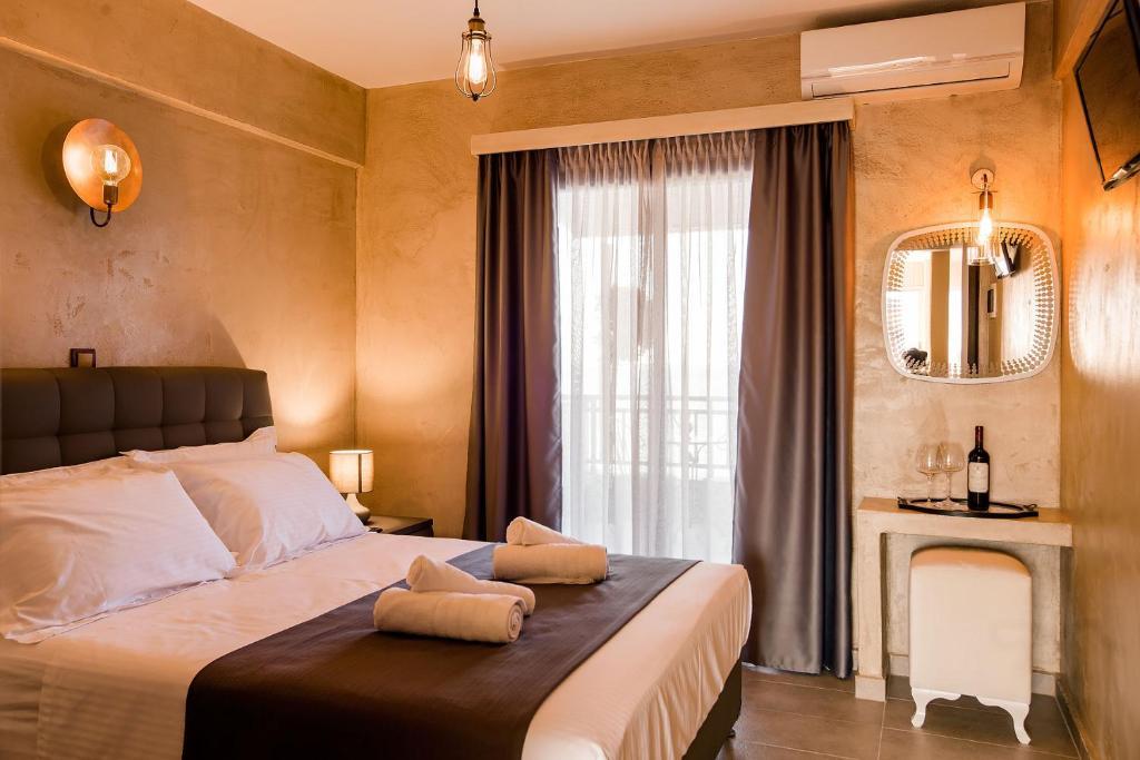 Ένα ή περισσότερα κρεβάτια σε δωμάτιο στο Rhapsody house