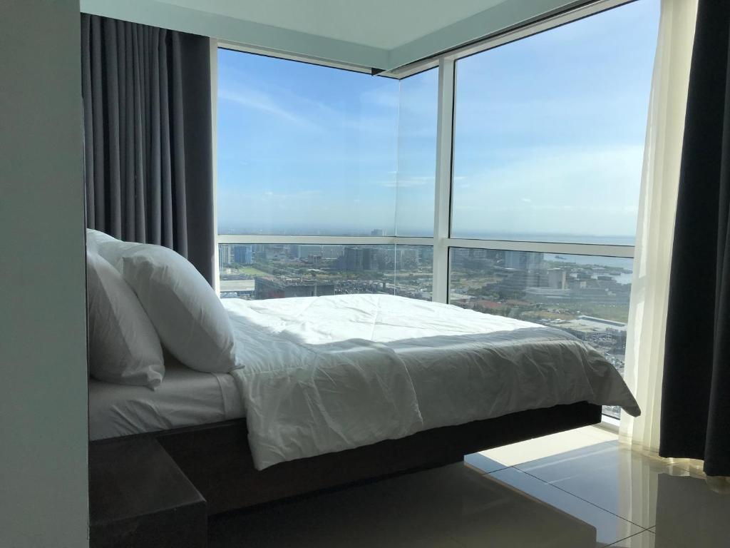 Ein Bett oder Betten in einem Zimmer der Unterkunft Breeze Deluxe Condominium