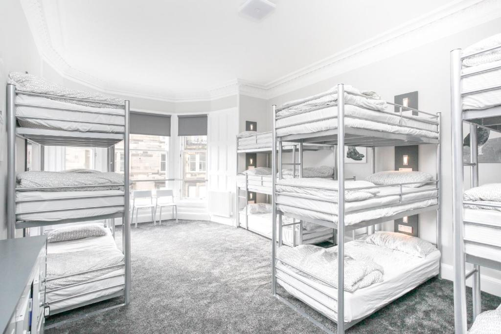 A bunk bed or bunk beds in a room at West End Hostel
