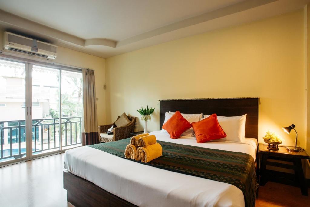 Кровать или кровати в номере Diamond Park Inn Chiangrai & Resort