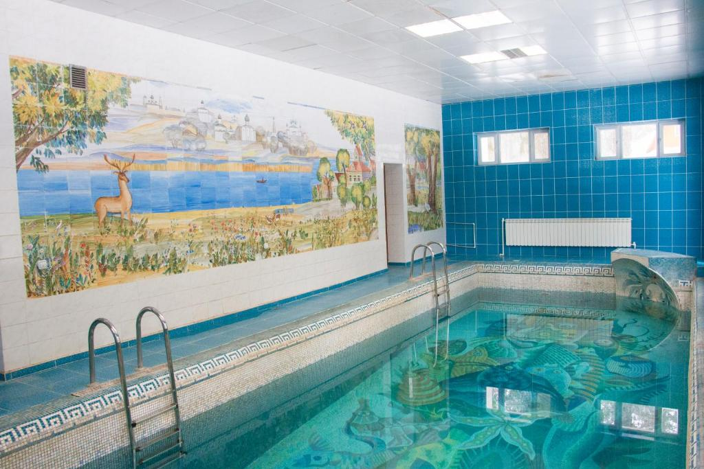 The swimming pool at or near Lesnaya Skazka Hotel
