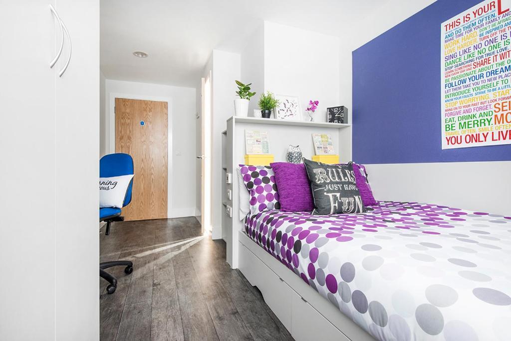 Ein Bett oder Betten in einem Zimmer der Unterkunft Ablett House (Campus Accommodation)