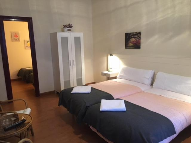 A bed or beds in a room at Hotel Covadonga
