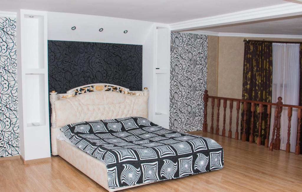 A bed or beds in a room at Lesnaya Skazka Hotel