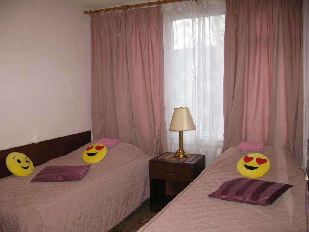 A bed or beds in a room at Kostyushko Apartment