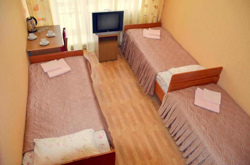 A bed or beds in a room at Hotel Veda