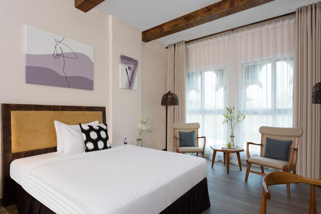 Ein Bett oder Betten in einem Zimmer der Unterkunft Park Regis Boutique Hotel