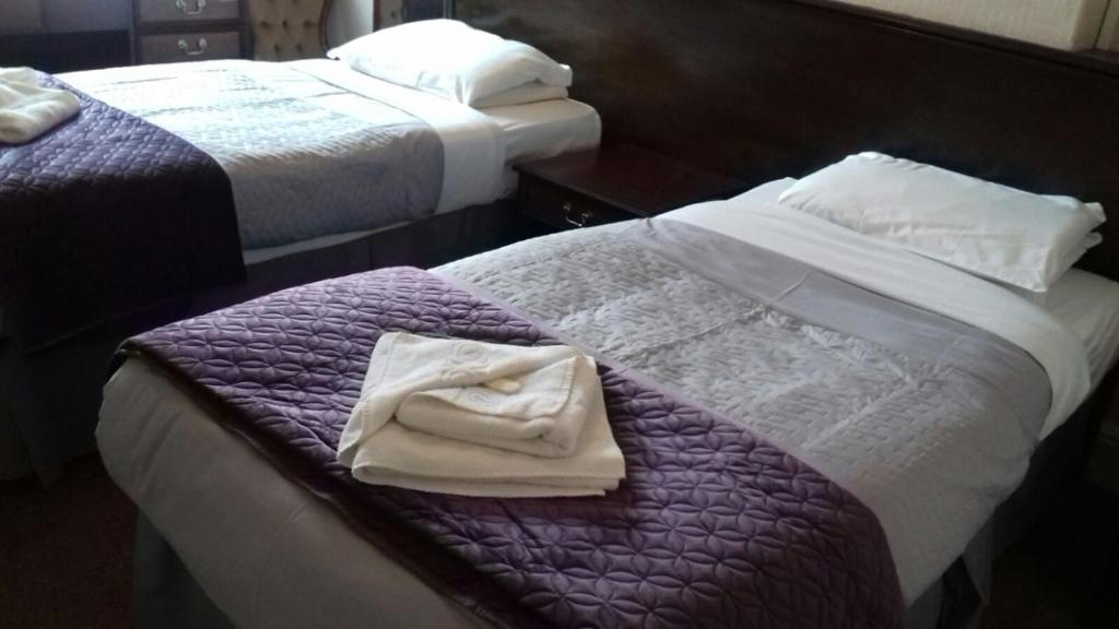 A bed or beds in a room at The Waverley Hotel Maryport