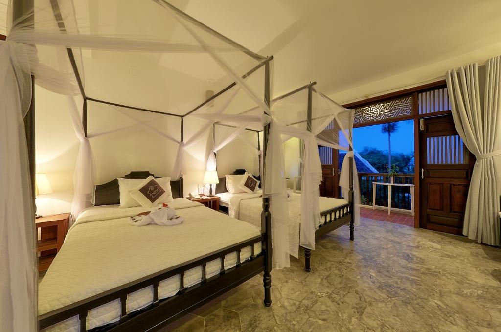 Phòng Grand Deluxe Giường đôi/2 Giường đơn với Ban công