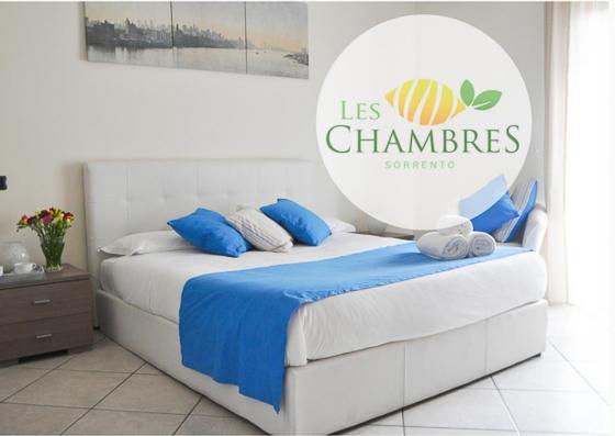 Letto o letti in una camera di Les Chambres Sorrento